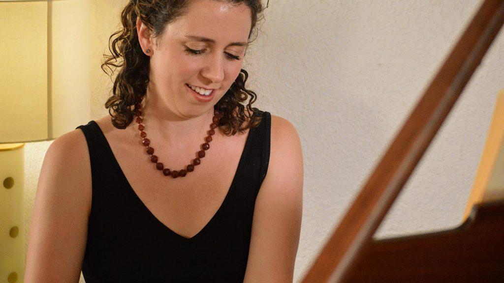 Sarah Gibson playing piano